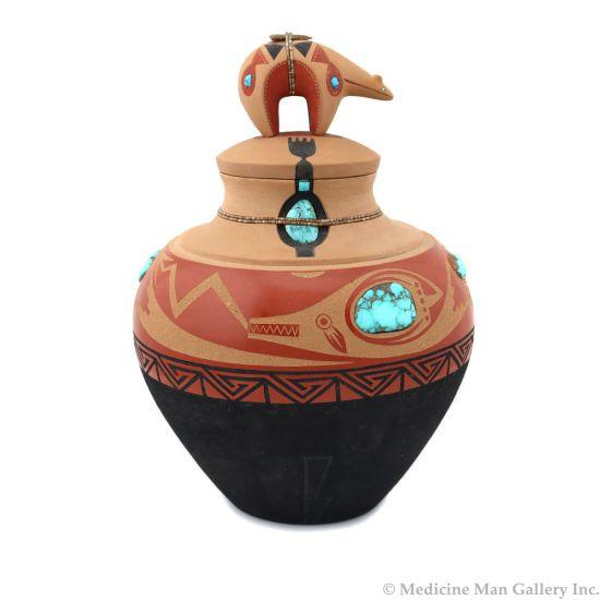 "Tony Da (1940-2008) - San Ildefonso Polychrome Lidded Bear Jar with Turquoise and Heishi Inlcusions, Arrowhead, and Carved Avanyu Design c. 1970s, 9"" x 6"" (P92348A-0621-062)"