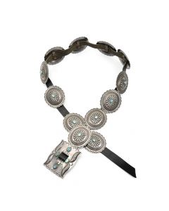 "Lot 177 - Roger Skeet, Jr. (b. 1933) - Navajo Leather Belt with Turquoise and Silver Conchos with Stamped Design c. 1960s, 33""-36"" waist (J91051-1018-029)"