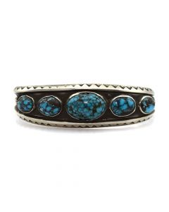 Lot 108 - Navajo Turquoise and Silver Bracelet with Stamped Designs c. 1930s, size 6.5 (J91051-1018-017)