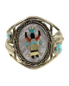 Lot 134 - Zuni Multi-Stone Inlay and Silver Bracelet with Ghan Dancer Design c. 1960s, size 6.5 (J10212)