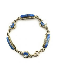 Raylan and Pattie Edaakie - Zuni Sodalite, Mother of Pearl, and Silver Bracelet with Sunface Kachina Design c. 1980s, size 7