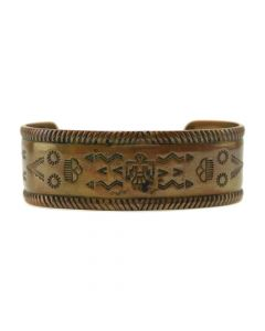 Bell Trading Post - Navajo Copper Bracelet with Stamped Thunderbird, Arrow, and Raincloud Designs c. 1930-40s, size 6.75 (J12293)