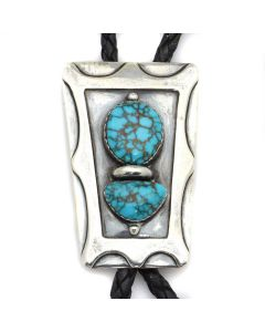 "The Navajo Hogan Shop - Navajo Turquoise, Silver, and Leather Bolo Tie c. 1950s, 2.75"" x 1.75"" (J13124-CO)"