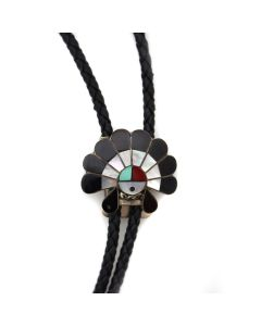 """Zuni Multi-Stone Channel Inlay, Silver, and Leather Bolo Tie with Sunface Kachina Design c. 1960-70s, 1"""" x 1.25"""" (J13553) 1"""