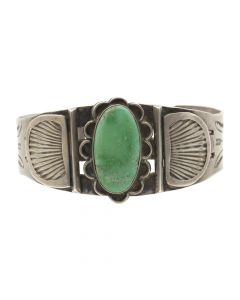 Lot 106 - Navajo Cerrillos Turquoise and Silver Bracelet with Stamped Arrow Designs c. 1920s, size 7 (J6233)