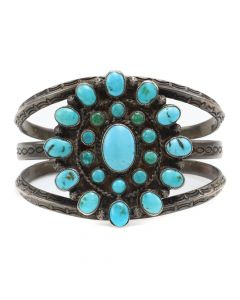Lot 104 - Navajo Turquoise Cluster and Silver Bracelet with Stamped Designs c. 1930s, size 6.75 (J7050)