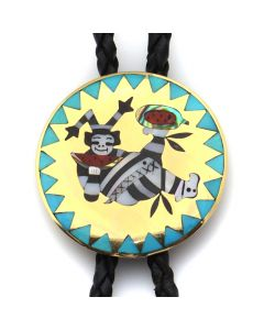 "Lot 173 - Dennis Edaakie (1931-2008) and Nancy Edaakie - Zuni Multi-Stone Inlay, 14KT Gold, and Leather Bolo Tie with Clown Kachina Design c. 1970s, 1.5"" x 1.5"" (J91051-0719-045)"