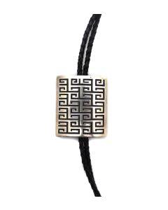 "Mark Tawahongva (b. 1948) - Hopi Silver Overlay and Leather Bolo Tie c. 1980s, 2.25"" x 2"" bolo (J91139A-0321-002)"