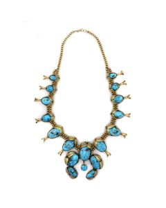 Navajo Persian Turquoise, 14K Gold, and Silver Squash Blossom Necklace c. 1970s; Includes Wooden Box with Carved Native American Pictorial and Turquoise Inclusions (J91643A-0321-003)