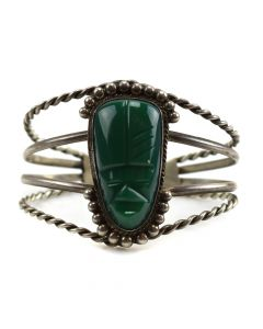 Mexican Silver Bracelet with Carved Aztec Face in Green Stone c. 1940-50s, size 6.5