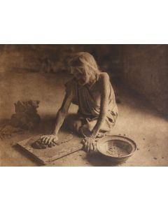 Edward S. Curtis (1868-1952) - The Potter Mixing Clay