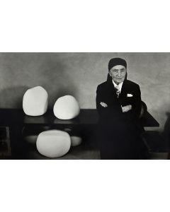 Dan Budnik (1933-2020) - Georgia O'Keeffe in the Ghost Ranch Potting Shed; Ceramic Pots by Juan Hamilton; March 1975 (PDC90211C-0121-004)