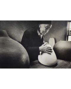Dan Budnik (1933-2020) - Georgia O'Keeffe at the Ghost Ranch with pots by Juan Hamilton; March 1975 (PDC90211C-0121-005)