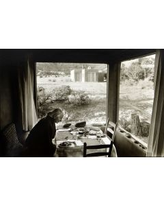 Dan Budnik (1933-2020) - Georgia O'Keeffe Dining Room, Sitting Down for Supper, Potting Shed in the Background; March 1975 (PDC90211C-0121-020)