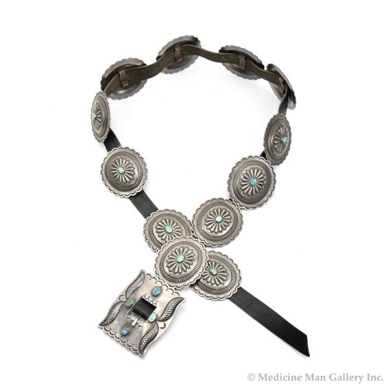 """Lot 177 - Roger Skeet, Jr. (b. 1933) - Navajo Leather Belt with Turquoise and Silver Conchos with Stamped Design c. 1960s, 33""""-36"""" waist (J91051-1018-029)"""