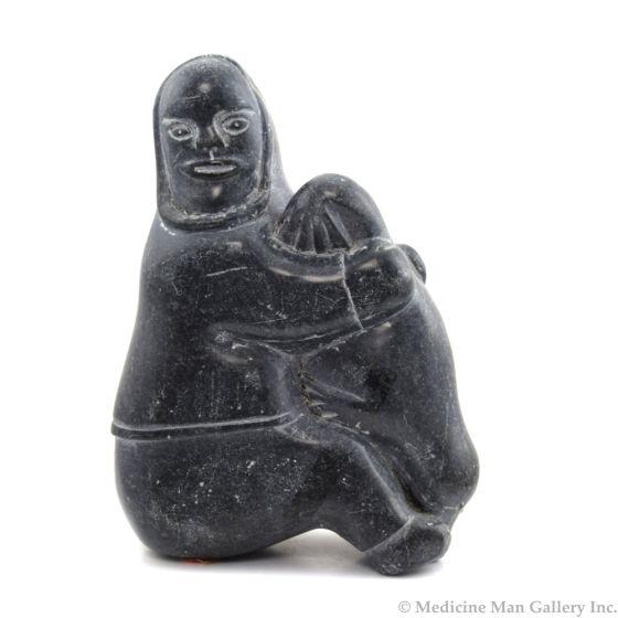 "Inuit Grey Soapstone Woman Sitting, Holding Seal c. 1980, 9.75"" x 6.75"" x 4"""