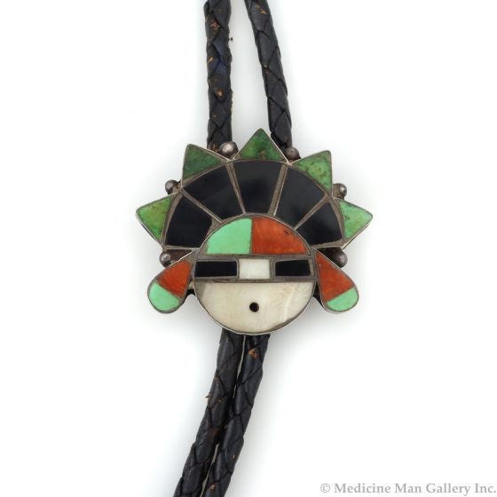 """Zuni Multi-Stone Channel Inlay, Silver, and Leather Bolo Tie with Sunface Kachina Design c. 1950s, 1.5"""" x 1.625"""" (J92336-0821-028)1"""