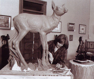Veryl Goodnight working on her life-sized piece High Country Summer in her studio in Colorado