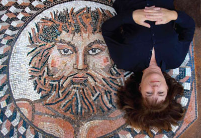 Anne reclines on Jupiter, mosaic entry art she made for a house designed by Dennis.