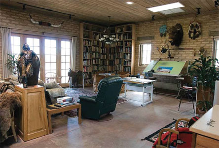 Deborah Copenhaver-Fellows' studio she shares with her husband. In the background is her father's saddle.