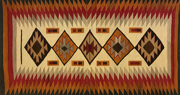 Navajo Red Mesa Rug c. 1915 with Mountain Mahogany Dye, Baskets, and Jewelry
