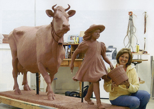 """Veryl Goodnight with Blue Bell Cow and Girl, Clay version of Bronze sculpture, 5.5"""" feet tall"""