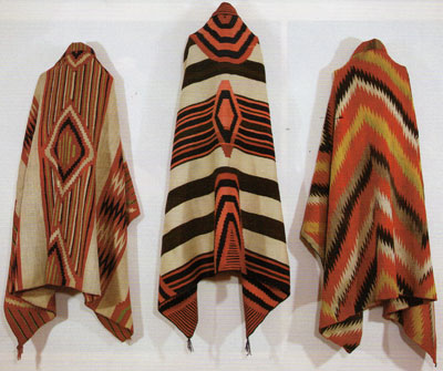 "Left to Right: Navajo Classic Serape with all natural dyes, c. 1860, 73"" x 52"", Navajo Third Phase Chiefs Blanket with Ravelled Bayeta, Cochineal, Lac and Indigo dyes, c. 1870, 50"" x 76.5"", Navajo Transitional textile, c. 1880, 73"" x 53"""