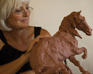 Jan Mapes fine-tunes her new sculpture, Hare Triggered