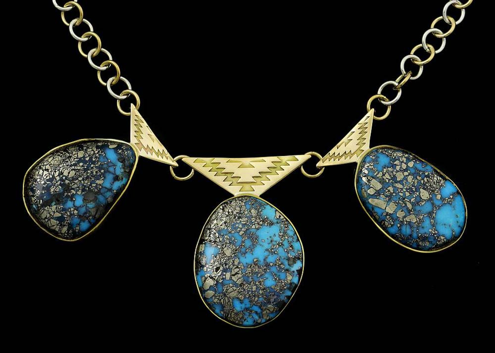 Necklace with gem-grade Kingman turquoise, 22K gold bezels, 18K gold emblem, sterling silver back on an 18K gold and silver chain