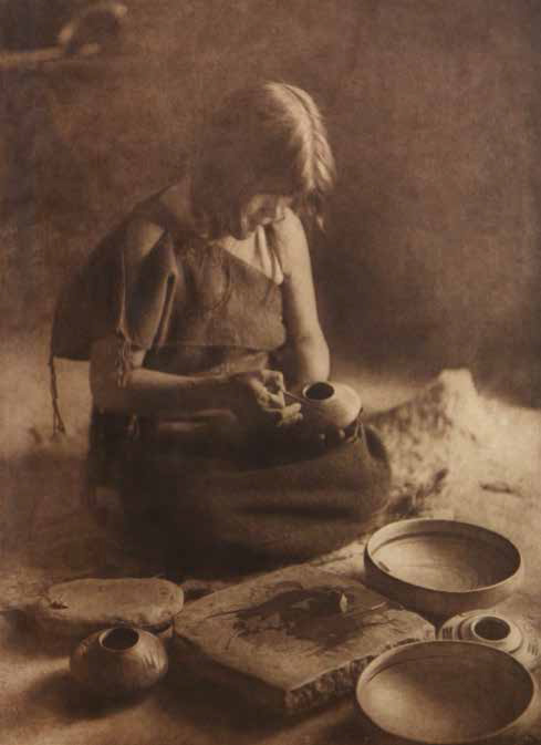 """Edward S. Curtis (1868-1952), The Potter, plate 426, ca. 1906, photogravure on Japanese vellum, 173⁄4 x 13"""". Photograph shows Nampeyo Old Lady of Hano."""