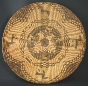 Apache pictorial tray with dogs and horses, circa 1900, 20 inches in diameter