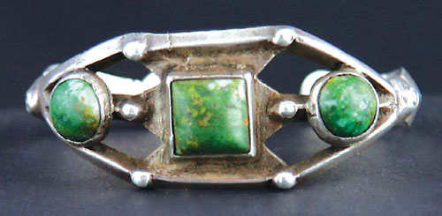 Early cast silver Navajo bracelet with turquoise
