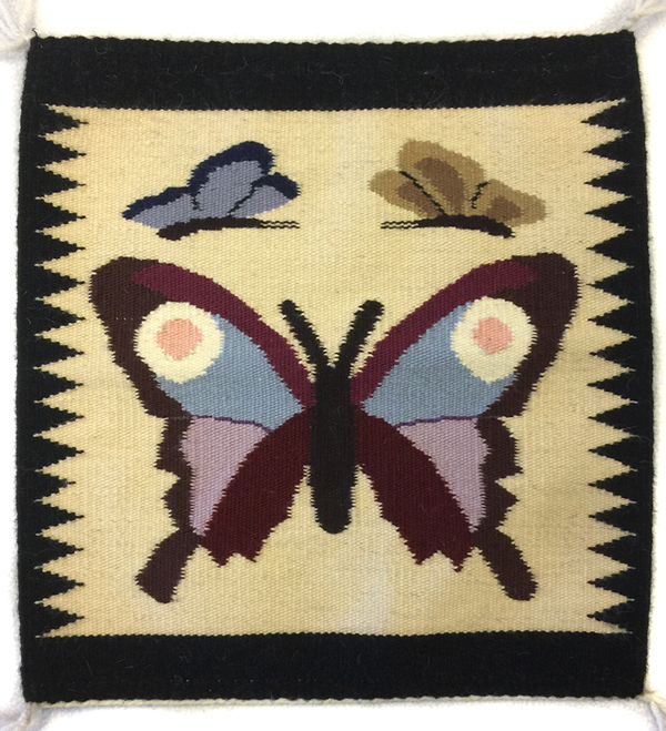 Navajo pictorial rug with butterflies