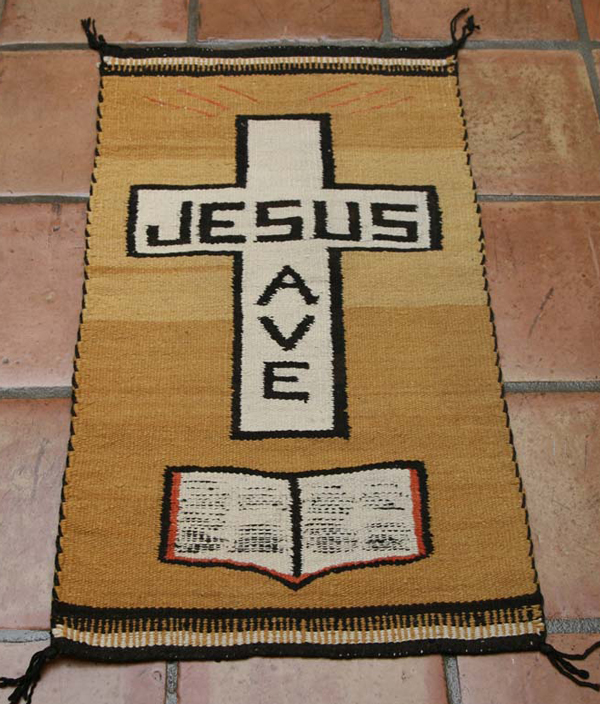 Navajo pictorial rug with Bible
