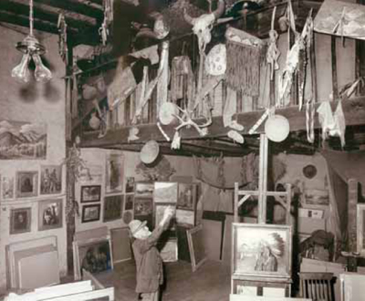 Sharp points to an Indian artifact in his Taos studio. PHOTO COURTESY BUFFALO BILL HISTORICAL CENTER, CODY, WY