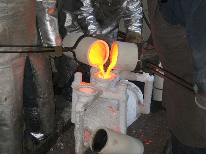 Carol Alleman, Voice of Wisdom, being poured with molten bronze
